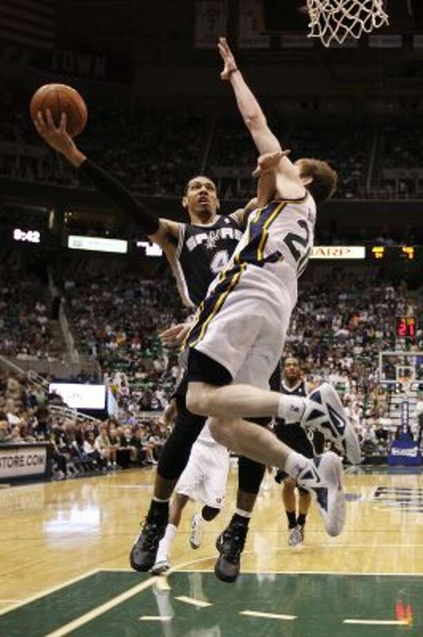 The Spurs'  Danny Green runs into the Jazz's Gordon Hayward in the second half of game three of the Western Conference first round at EnergySolutions Arena in Salt Lake City, Saturday, May 5, 2012.  The Spurs won 102-90 and lead the series 3-0. Jerry Lara/San Antonio Express-News (Jerry Lara / San Antonio Express-News)