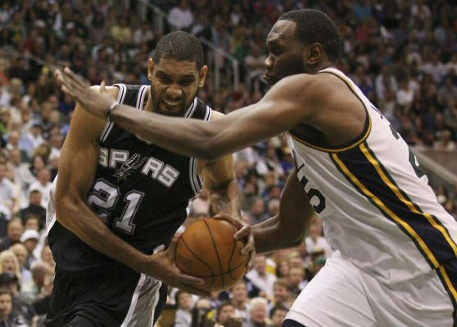 The Spurs'  Tim Duncan tries get through the Jazz's Al Jefferson in the first half of game three of the Western Conference first round at EnergySolutions Arena in Salt Lake City,  Saturday, May 5, 2012.  Jerry Lara/San Antonio Express-News (Jerry Lara / San Antonio Express-News)