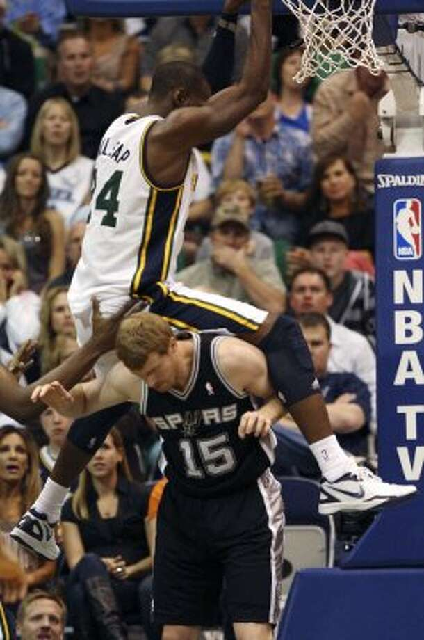 The Spurs'  Matt Bonner gets called for a foul on the Jazz's Paul Millsap in the first half of game three of the Western Conference first round at EnergySolutions Arena in Salt Lake City,  Saturday, May 5, 2012.  Jerry Lara/San Antonio Express-News (Jerry Lara / San Antonio Express-News)