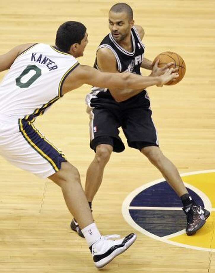 The Spurs'  Tony Parker looks for room around the Jazz's Enes Kanter during second half action of Game 3 of the Western Conference first round Saturday May 5, 2012 at EnergySolutions Arena in Salt Lake City, Utah. The Spurs won 102-90. EDWARD A. ORNELAS/SAN ANTONIO EXPRESS-NEWS (EDWARD A. ORNELAS / SAN ANTONIO EXPRESS-NEWS)