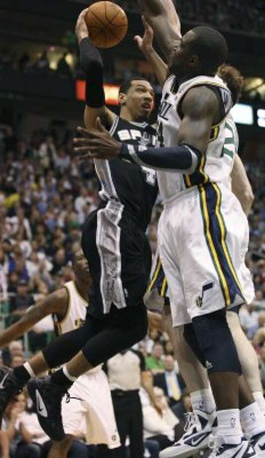 The Spurs'  Danny Green tries to get through the Jazz's Paul Millsap and Gordon Hayward in the first half of game three of the Western Conference first round at EnergySolutions Arena in Salt Lake City,  Saturday, May 5, 2012.  Jerry Lara/San Antonio Express-News (Jerry Lara / San Antonio Express-News)