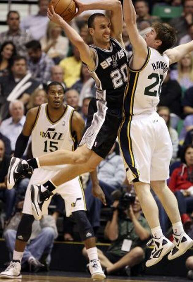 The Spurs'  Manu Ginobili passes out to the perimeter as the Jazz's Gordon Hayward tries to block him in the second half of game three of the Western Conference first round at EnergySolutions Arena in Salt Lake City,  Saturday, May 5, 2012.  The Spurs won 102-90 and lead the series 3-0. Jerry Lara/San Antonio Express-News (Jerry Lara / San Antonio Express-News)