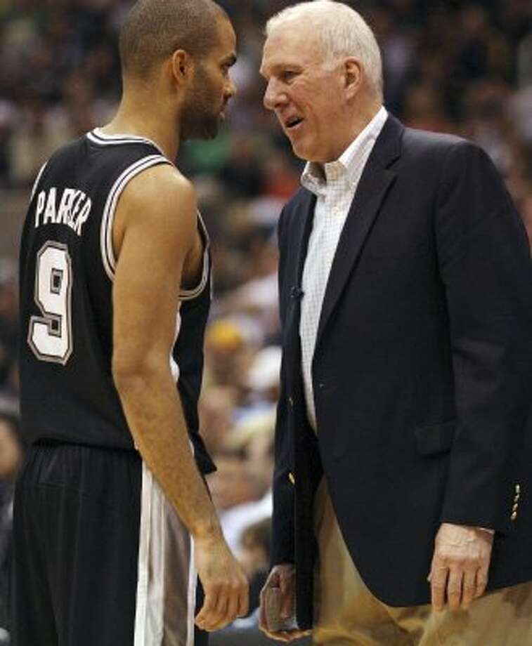 Spurs coach Gregg Popovich talks with Tony Parker during a break in the second half of game three of the Western Conference first round at EnergySolutions Arena in Salt Lake City,  Saturday, May 5, 2012.  The Spurs beat the Utah Jazz, 102-90, and lead the series 3-0. Jerry Lara/San Antonio Express-News (Jerry Lara / San Antonio Express-News)
