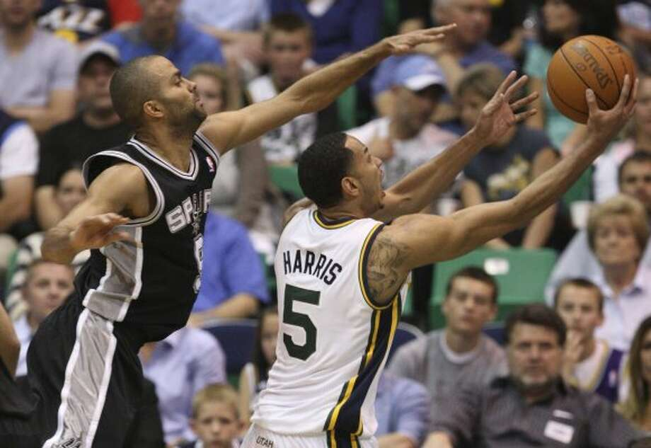 The Spurs'  Tony Parker tries to block the Jazz's Devin Harris in the first half of game three of the Western Conference first round at EnergySolutions Arena in Salt Lake City,  Saturday, May 5, 2012.  Jerry Lara/San Antonio Express-News (Jerry Lara / San Antonio Express-News)