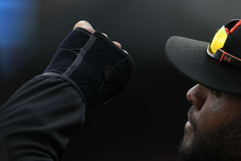 Is the grip that Pablo Sandoval uses on the bat to blame for the broken bones in his hands the past two seasons? Photo: Stephen Lam, Special To The Chronicle
