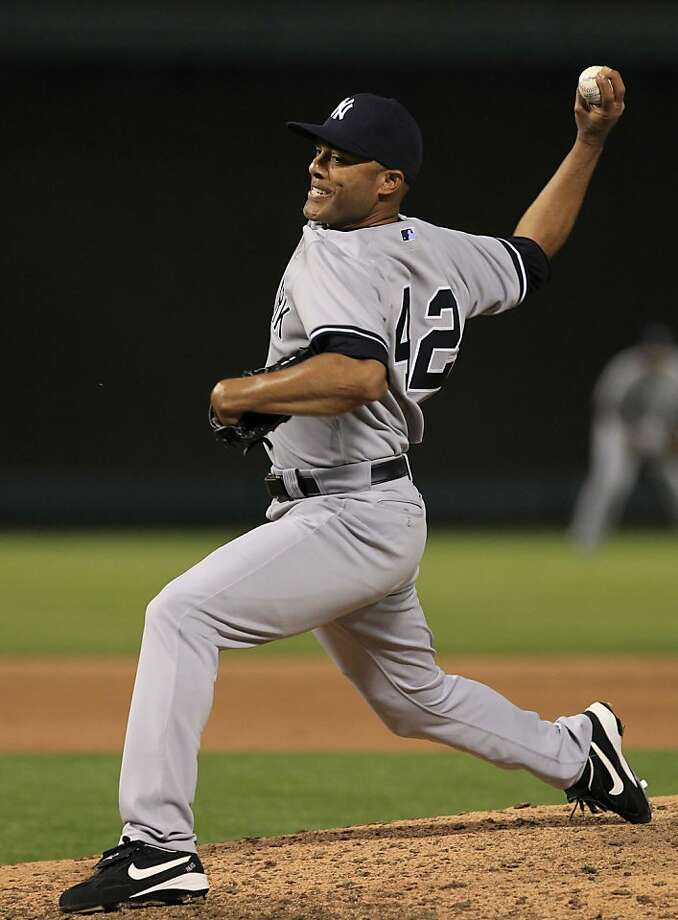 New York Yankees closer Mariano Rivera (42) deliver during the ninth inning of the baseball game against the Texas Rangers Monday, April 23, 2012, in Arlington, Texas. The Yankees won 7-4.  (AP Photo/LM Otero) Photo: LM Otero, Associated Press