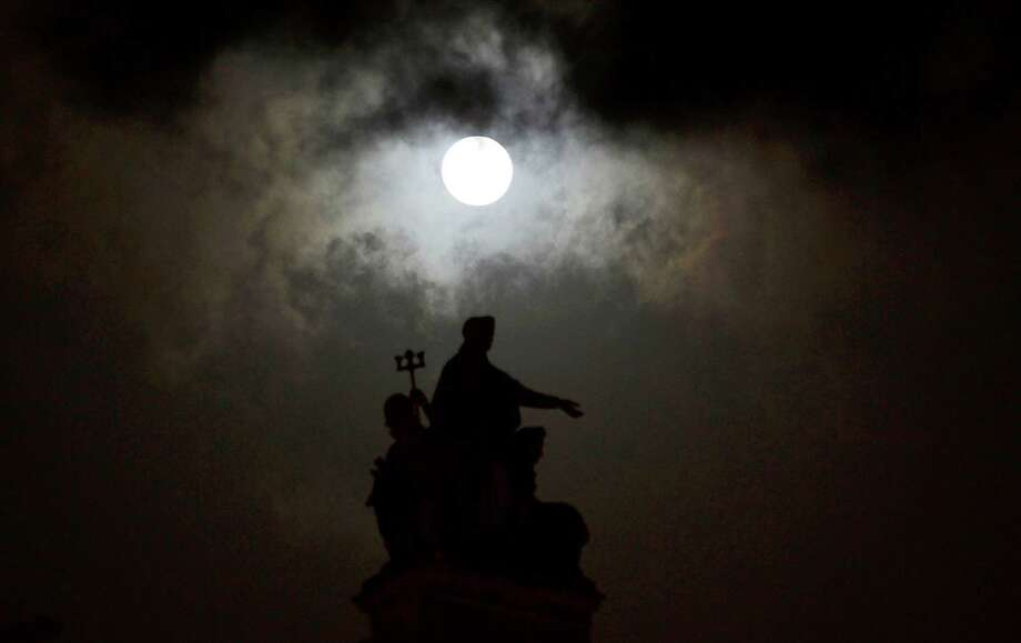 "The ""supermoon"" appears over the landmark Chhatrapati Shivaji Terminus in Mumbai, India, Saturday, May 5, 2012. The moon was the closest it will get to the Earth this year _ and appeared 14 percent larger because of that. At its peak it was about 221,802 miles from Earth. (AP Photo/ Rajanish Kakade) Photo: Rajanish Kakade, Associated Press / Copyright 2012 The Associated Press. All rights reserved. This material may not be published, broadcast, rewritten or redistribu"