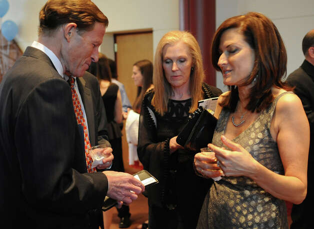 Senator Richard Blumenthal speaks to Andrea Marella during a benefit for Dana's Angels Research Trust (DART) at the Palace Theatre on Saturday, May 5, 2012. Photo: Lindsay Niegelberg / Stamford Advocate