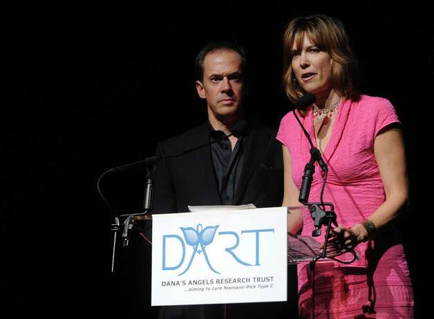 Dan Hicks of NBC Sports and his wife, Hannah Storm of ESPN, speak during a benefit for Dana's Angels Research Trust (DART) at the Palace Theatre on Saturday, May 5, 2012. Photo: Lindsay Niegelberg / Stamford Advocate