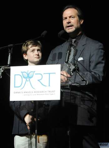 Phil Marella and his son, Andrew, speak during a benefit for Dana's Angels Research Trust (DART) at the Palace Theatre on Saturday, May 5, 2012. Photo: Lindsay Niegelberg / Stamford Advocate