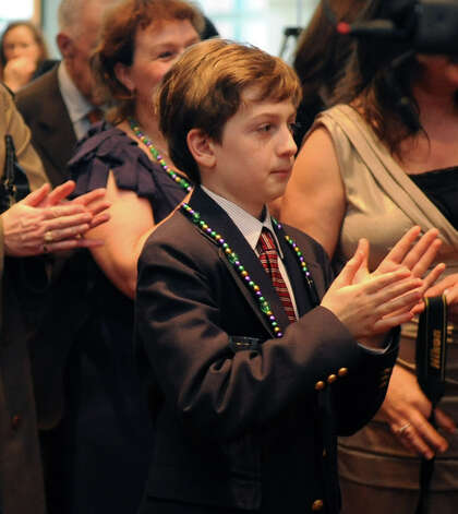 Andrew Marella, son of Andrea and Phil Marella, claps during a benefit for Dana's Angels Research Trust (DART) at the Palace Theatre on Saturday, May 5, 2012. Andrew was diagnosed with Niemann-Pick type C three years after his sister, Dana, whom the trust is named after, was diagnosed with the same rare degenerative disease. Photo: Lindsay Niegelberg / Stamford Advocate