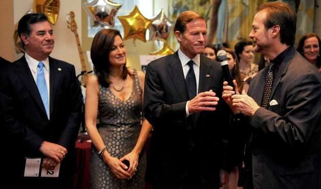 From left, Mayor Michael Pavia, Andrea Marella, Senator Richard Blumenthal and Phil Marella speak during a benefit for Dana's Angels Research Trust (DART) at the Palace Theatre on Saturday, May 5, 2012. Photo: Lindsay Niegelberg / Stamford Advocate