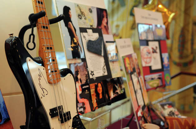Items available for silent auction included a guitar signed by Sting and Yankees tickets, among other items, during a benefit for Dana's Angels Research Trust (DART) at the Palace Theatre on Saturday, May 5, 2012. Photo: Lindsay Niegelberg / Stamford Advocate