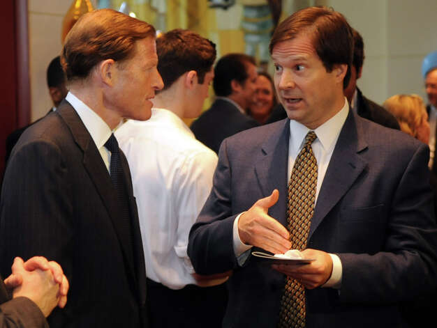 Senator Richard Blumenthal speaks to a guest during a benefit for Dana's Angels Research Trust (DART) at the Palace Theatre on Saturday, May 5, 2012. Photo: Lindsay Niegelberg / Stamford Advocate