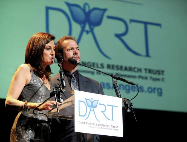 Andrea and Phil Marella speak during a benefit for Dana's Angels Research Trust (DART) at the Palace Theatre on Saturday, May 5, 2012. The trust is named in honor of the Marella's daughter, Dana, who has Niemann-Pick Type C, a rare and degenerative disease. Photo: Lindsay Niegelberg / Stamford Advocate