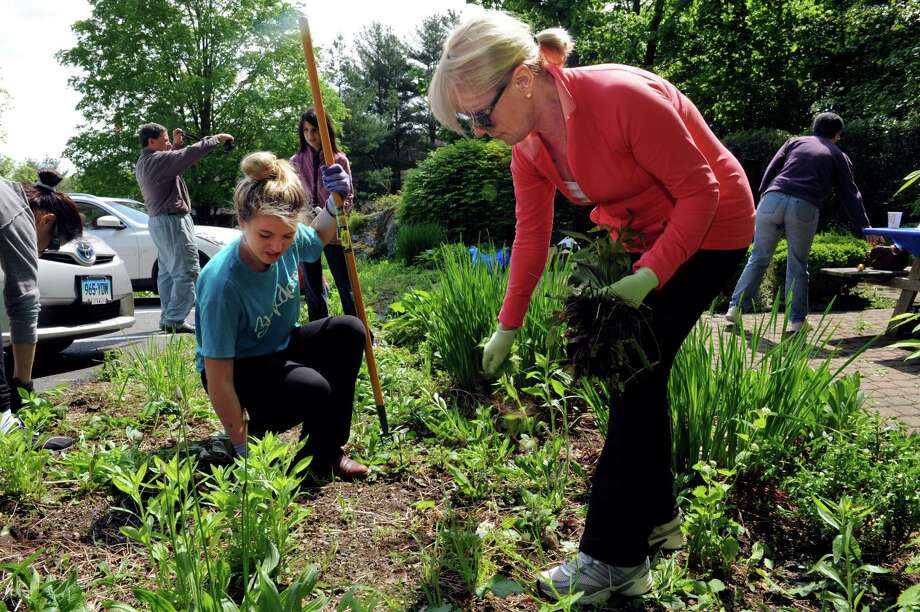 "Victoria Stein, 16, left, and her mother, Bozenna Stein, beautify the 9/11 memorial garden at Jewish Family Services Sunday, May 6, 2012. Congregation Shir Ami held a weekend of community service awareness and action called ""Tikvah Weekend."" Photo: Helen Neafsey / Greenwich Time"