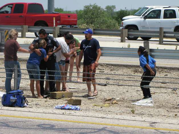 Friends and relatives react at the scene of a rollover crash that killed two children on the South Side Sunday afternoon, May 6, 2012. Photo: Eva Ruth Moravec, San Antonio Express-News / emoravec@express-news.net