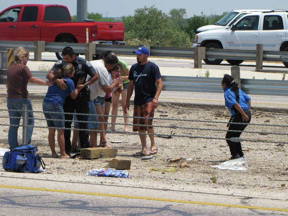 Friends and relatives react at the scene of a rollover crash that killed two children on the Southwest Side Sunday afternoon, May 6, 2012. Photo: Eva Ruth Moravec, San Antonio Express-News / emoravec@express-news.net