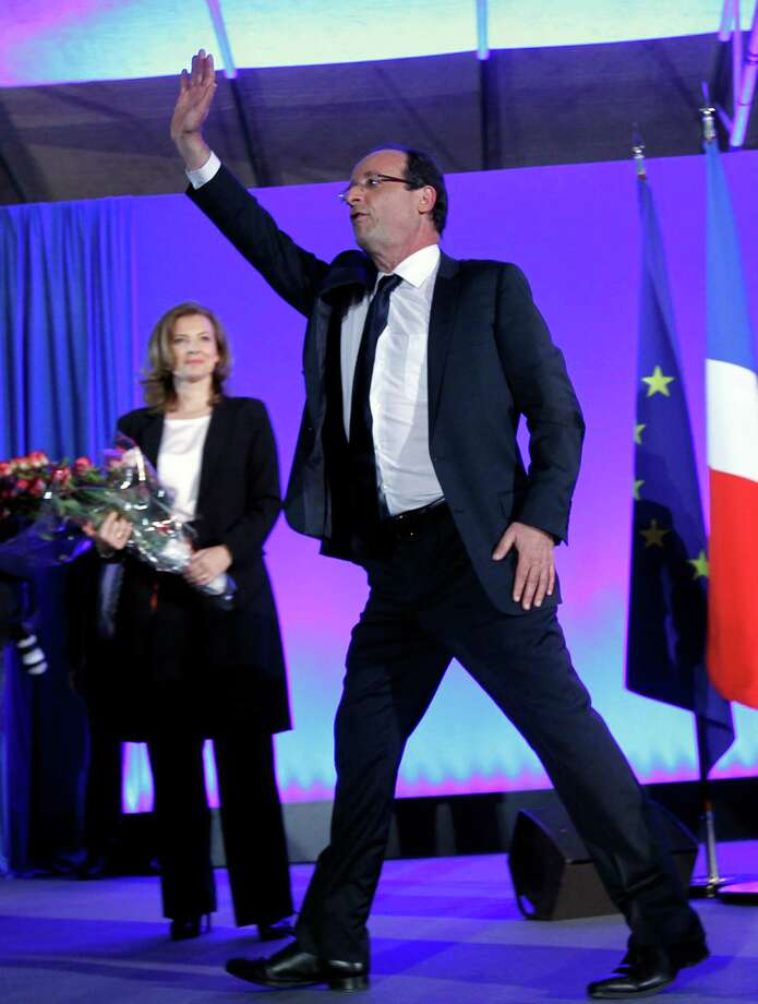 President-elect Francois Hollande waves to the crowd after his election in Tulle, central France, Sunday, May 6, 2012.  Francois Hollande defeated Nicolas Sarkozy on Sunday to become France's next president, Sarkozy conceded defeat minutes after the polls closed. (AP Photo/Christophe Ena) Photo: Christophe Ena / AP