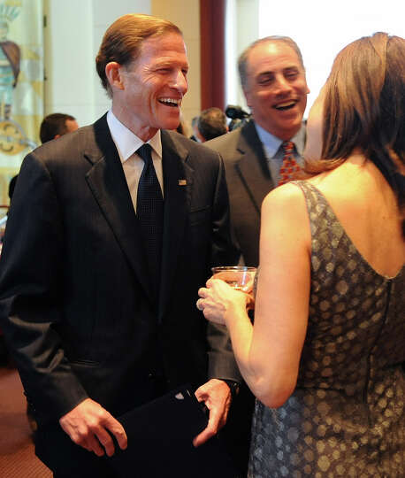 Senator Richard Blumenthal speaks to Andrea Marella during a benefit for Dana's Angels Research Trus