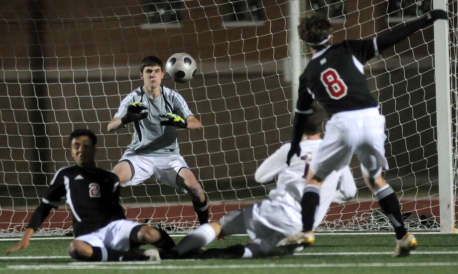 Staying focused was easy for Langham Creek junior goalkeeper Connor Harwell, center, who was a save machine on his way to being named the defensive player of the year in District 17-5A. Photo: Jerry Baker