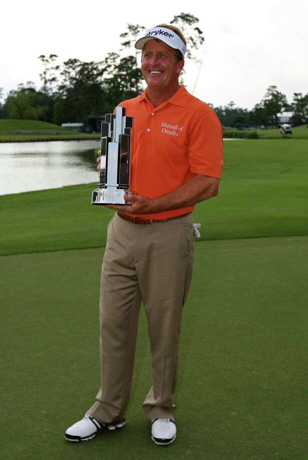 Fred Funk poses with the winner's trophy after winning the Insperity Championship, Sunday, May 6, 2012 at the Tournament Course in The Woodlands, TX. Funk shot 14-under par, one shot better than runner-up Tom Lehman. Photo: Eric Christian Smith, For The Chronicle