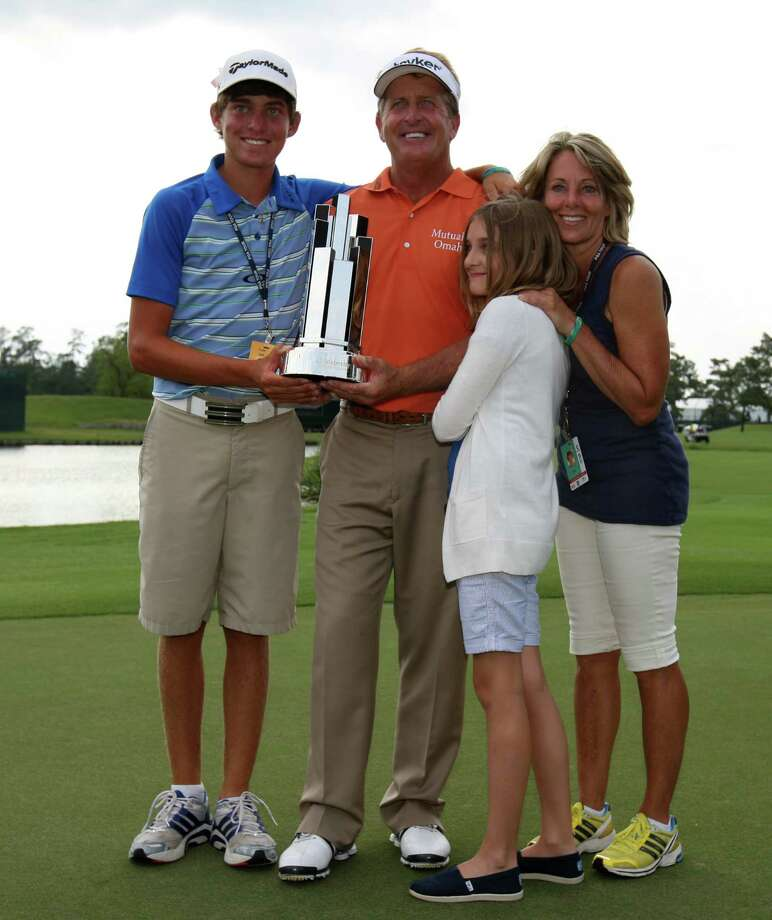 Final round, May 6 - Fred Funk (second from left) and family, Taylor (left), Perry, and wife Sharon pose with Funk's winner's trophy after Funk won the Insperity Championship, Sunday, May 6, 2012 at the Tournament Course in The Woodlands, TX. Photo: Eric Christian Smith, For The Chronicle