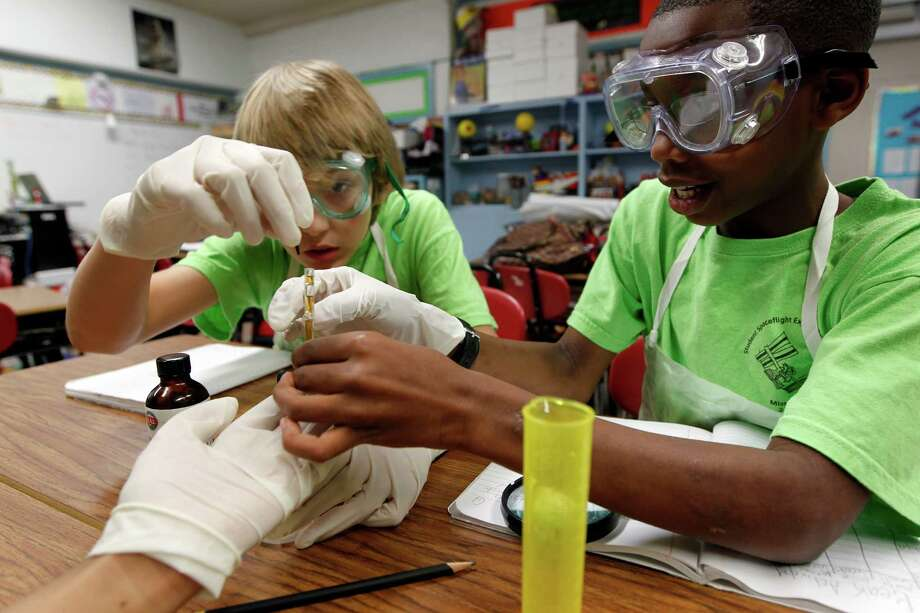 Maxx Denning, left, and Michael Prince, both fifth-graders at Parker Elementary, are working on one of 15 nationwide experiments chosen to fly to the International Space Station later this month. Photo: James Nielsen / © 2012 Houston Chronicle