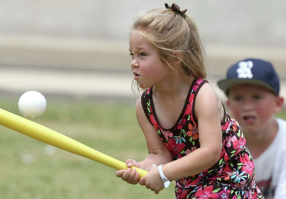 Houston residents Kylie Roy, 4, takes a swing while playing baseball with her brother Caden Roy 6, while taking in the Rice/UH baseball game at Reckling Park on Sunday, May 6, 2012 in Houston, Texas.   ( J. Patric Schneider / For the Chronicle ) Photo: J. Patric Schneider / Houston Chronicle