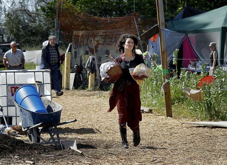 Neighbors and supporters continue to bring water and food to the garden. Despite rumors of a crackdown on the garden planted by Occupy forces at UC's experimental garden facility in Albany, Calif., farming went on although the water is still shut off. Photo: Brant Ward, The Chronicle