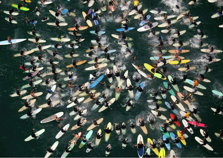 Friends and fans of former San Diego Chargers linebacker Junior Seau, who committed suicide Wednesday at his home in Oceanside, Calif., participate in a paddle-out memorial in the water in front of his home Sunday, May 6, 2012. Photo: Howard Lipin, Associated Press / 2012, U-T San Diego