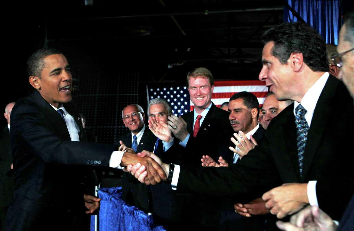 FILE - In this Sept. 21, 2009 file photo, President Barack Obama greets New York Attorney General Andrew Cuomo, right, as New York Gov. David Paterson is seen second from right, before Obama speaks at Hudson Valley Community College in Troy, N.Y. When President Obama comes to New York, Tuesday, May 8, 2012, to visit a computer chip plant north of Albany, Gov. Cuomo will be there, and the chemistry between the two inevitably will be scrutinized. (AP Photo/Charles Dharapak, File)