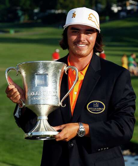 Rickie Fowler holds the trophy after winning the Wells Fargo Championship golf tournament at Quail Hollow Club in Charlotte, N.C., Sunday, May 6, 2012. (AP Photo/Gerry Broome) Photo: Gerry Broome / AP