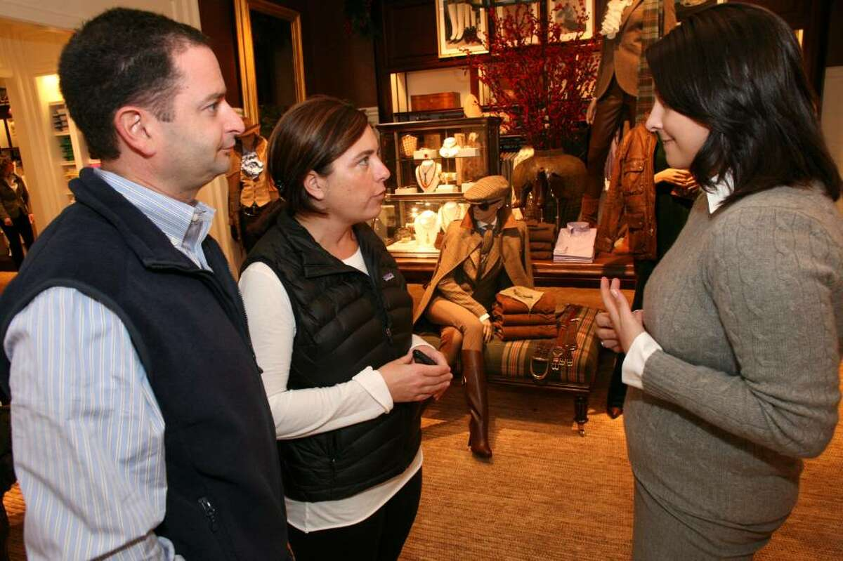 Cathy and Robert Carangelo spoke with Ralph Lauren sales associate Jasmine Bezirdjian during opening day of the new retail shop on Greenwich Avenue.