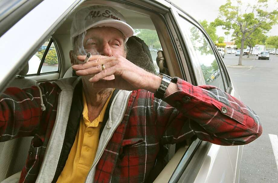 Bill Trimmer, of Hayward, smokes a cigarette inside his car as he waits for a cigarette discount  store to open, on Friday May 4, 2012,  in Hayward, Ca. California voters are voting soon on whether to increase the tobacco tax with an increase a $1-a-pack that would fund research on cancer and other tobacco related illnesses. Photo: Michael Macor, The Chronicle