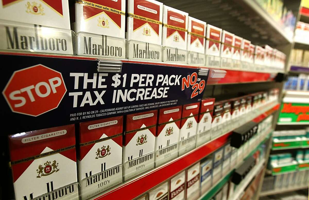 A discount cigarette store, in Hayward, Ca., on Friday May 4, 2012, displays the tobacco industry's take on Prop 29. California voters are voting soon on whether to increase the tobacco tac with an increase a $1-a-pack that would fund research on cancer and other tobacco related illnesses.