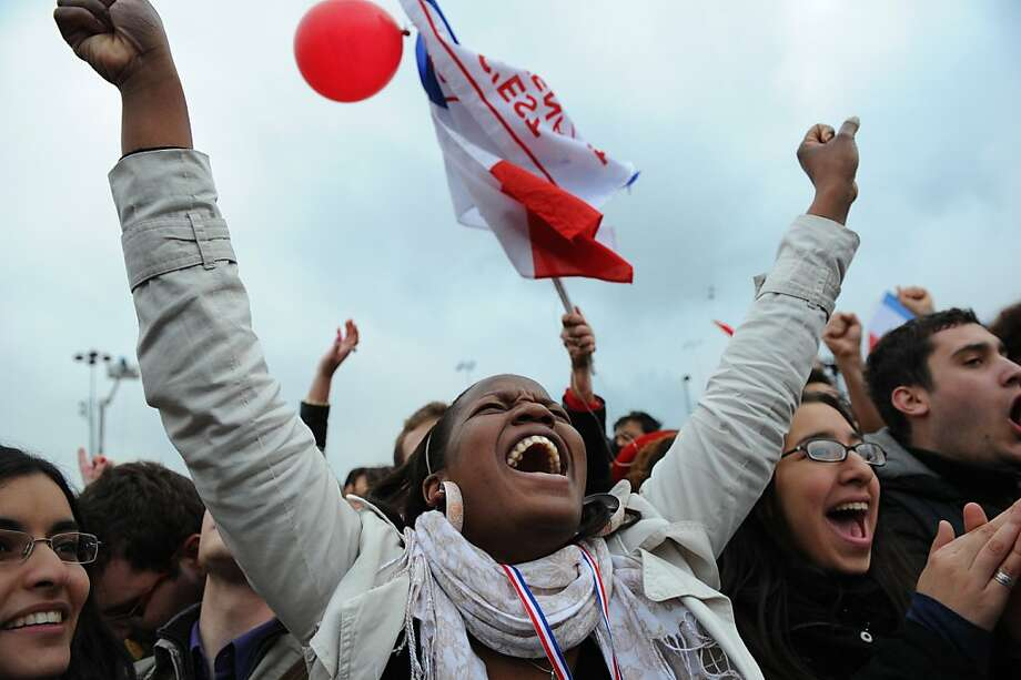 Supporters of Socialist Party (PS) candidate for the 2012 French presidential election celebrate at the Place de la Bastille in Paris on May 6, 2012 after the announcement of the first official results of the French presidential final round. Socialist candidate Francois Hollande won the French presidential election today with between 52 and 53 percent of the vote, ousting right-wing incumbent Nicolas Sarkozy, according to estimates.  AFP PHOTO / FRANCK FIFEFRANCK FIFE/AFP/GettyImages Photo: Franck Fife, AFP/Getty Images