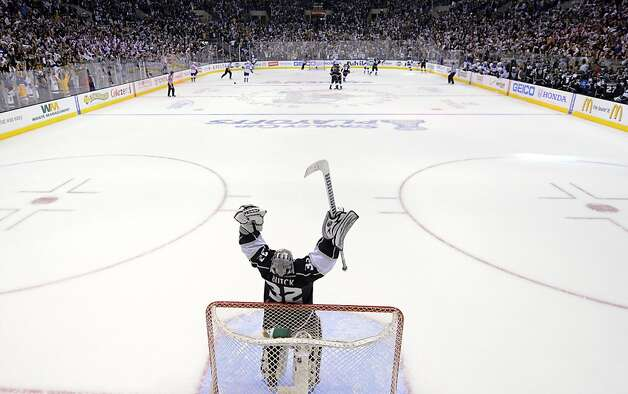 Los Angeles Kings goalie Jonathan Quick celebrates after the Kings scored an empty-net goal against the St. Louis Blues during the third period in Game 4 of an NHL hockey Stanley Cup second-round playoff series, Sunday, May 6, 2012, in Los Angeles. The Kings won 3-1 to win the series 4-0. (AP Photo/Mark J. Terrill) Photo: Mark J. Terrill, Associated Press