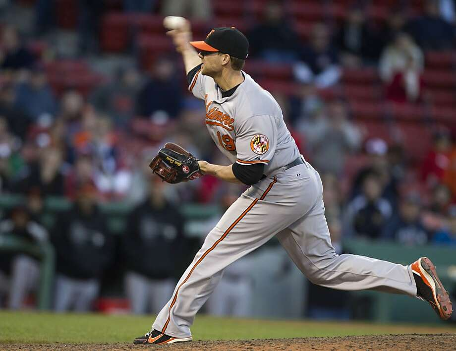 Baltimore Orioles' Chris Davis delivers a pitch against Boston Red Sox during the 16th inning of a baseball game at Fenway Park, in Boston on Sunday, May 6, 2012. The Orioles defeated the Red Sox 9-6 in 17 innings. (AP Photo/Steven Senne) Photo: Steven Senne, Associated Press