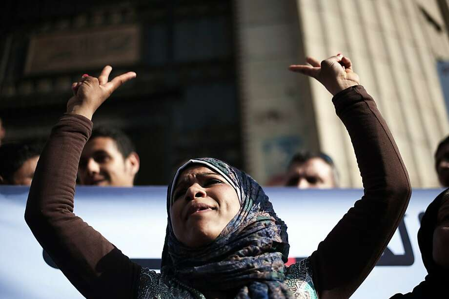 An Egyptian anti-military protester flashes the sign for victory during a demonstration outside the Egyptian Supreme House of Justice in Cairo to demand for the release of hundreds of detained demonstrators on May 6, 2012. Egypt's military on May 5 ordered 300 people arrested after deadly clashes between troops and anti-army protesters in Cairo and imposed a new curfew, as tensions spiral ahead of a key presidential poll.     TOPSHOTS/AFP PHOTO/GIANLUIGI GUERCIAGIANLUIGI GUERCIA/AFP/GettyImages Photo: Gianluigi Guercia, AFP/Getty Images