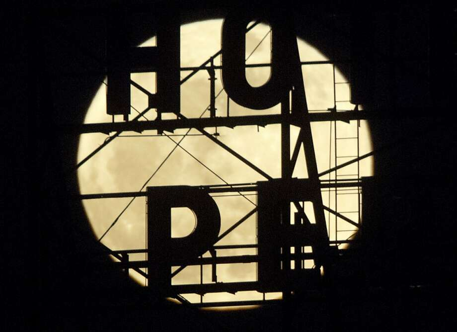 "A ""supermoon"" appears above the temporarily closed Hotel Pere Marquette on Saturday, May 5, 2012, in Peoria, Ill. This ""supermoon"" is the closest moon of the year, coming within 221, 802 miles from Earth. (AP Photo/Journal Star, Adam Gerik)  MANDATORY CREDIT Photo: Adam Gerik, Associated Press"
