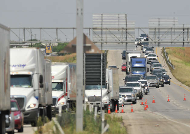 Traffic was diverted off Interstate 35 South near Loop 410 Sunday afternoon, May 6, 2012 after a car accident that killed two children. Photo: Robin Jerstad, For The Express-News