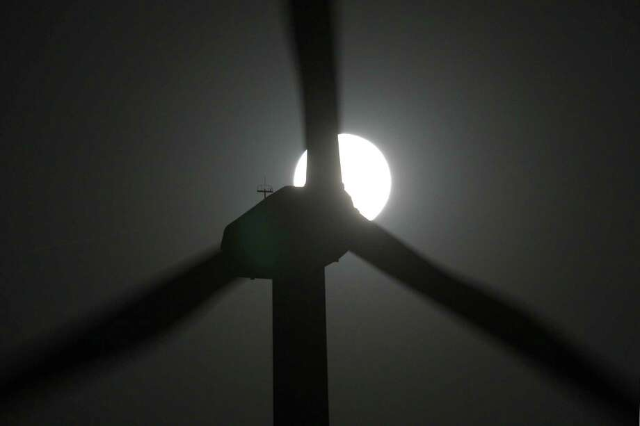 PALM SPRINGS, CA - MAY 5:  A perigee moon, or supermoon, rises behind wind turbines on May 5, 2012 near Palm Springs, California. The moon appears especially big and bright during this once-a-year cosmic event as the full moon is at its closest to the Earth in its elliptical orbit. The perigee side of its orbit is about 31,000 miles closer than the opposite, or apogee, side. The bright light of the full moon also hides all but the brightest meteors of the Eta Aquarid meteor shower, the remnant debris trail of Halley's Comet. Photo: David McNew, Getty Images / 2012 Getty Images