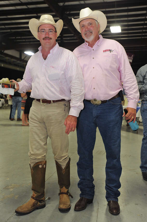 From left, Don Hansen and Shawn Walker show off their boots at the Cattle Barron's Ball on Saturday.  Photo taken Saturday, May 5, 2012 Guiseppe Barranco/The Enterprise Photo: Guiseppe Barranco, STAFF PHOTOGRAPHER / The Beaumont Enterprise