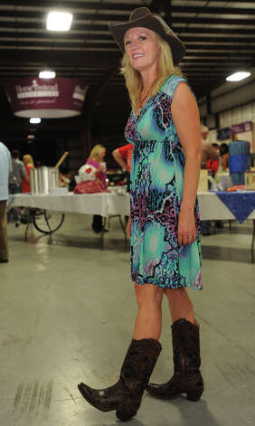 Darleen Greg show off her boots at the Cattle Barron's Ball on Saturday.  Photo taken Saturday, May 5, 2012 Guiseppe Barranco/The Enterprise Photo: Guiseppe Barranco, STAFF PHOTOGRAPHER / The Beaumont Enterprise
