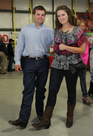 Dan Wamhoff and Danielle Wamhoff show off their boots at the Cattle Barron's Ball on Saturday.  Photo taken Saturday, May 5, 2012 Guiseppe Barranco/The Enterprise Photo: Guiseppe Barranco, STAFF PHOTOGRAPHER / The Beaumont Enterprise