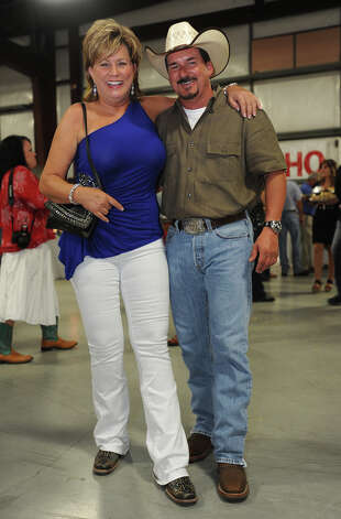 Vanette Young and Rich Williams show off their boots at the Cattle Barron's Ball on Saturday.  Photo taken Saturday, May 5, 2012 Guiseppe Barranco/The Enterprise Photo: Guiseppe Barranco, STAFF PHOTOGRAPHER / The Beaumont Enterprise