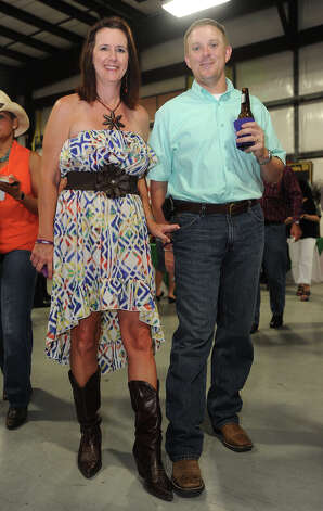 Tracie Billeaud and Lance Billeaud show off their boots at the Cattle Barron's Ball on Saturday.  Photo taken Saturday, May 5, 2012 Guiseppe Barranco/The Enterprise Photo: Guiseppe Barranco, STAFF PHOTOGRAPHER / The Beaumont Enterprise