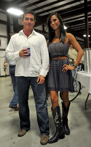 David Parkus and Joanna Wortham show off their boots at the Cattle Barron's Ball on Saturday.  Photo taken Saturday, May 5, 2012 Guiseppe Barranco/The Enterprise Photo: Guiseppe Barranco, STAFF PHOTOGRAPHER / The Beaumont Enterprise