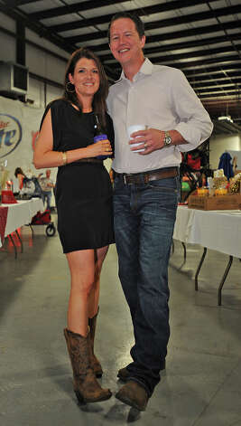 Tiffany Major and Ben Major show off their boots at the Cattle Barron's Ball on Saturday.  Photo taken Saturday, May 5, 2012 Guiseppe Barranco/The Enterprise Photo: Guiseppe Barranco, STAFF PHOTOGRAPHER / The Beaumont Enterprise